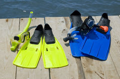 Flippers. Colorful flippers on a pier near the ocean Stock Photos