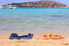 Flippers on the beach Royalty Free Stock Photos