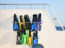 Flippers after a dive. Flippers in racks on a boat Royalty Free Stock Photo