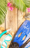 Flippers, goggles and snorkel on tropical beach Royalty Free Stock Image