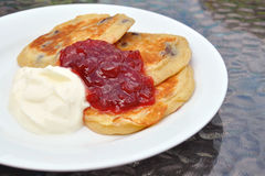 Flippers, jam and cream on white plate Stock Images