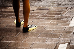 FLippers. Man wearing flippers in the street Stock Images