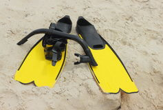 Flippers and mask on a sand Stock Images