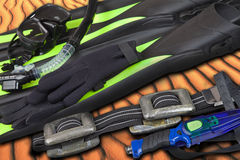 Flippers, mask, snorkel, diving knife and belt on the sea sand Stock Images