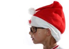 Flippiges Weihnachtskind mit Gläsern stockbild