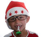 Flippiges Weihnachtskind mit Gläsern Stockfotografie