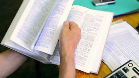 Flipping book dictionary stock footage