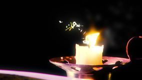 The book lies on the table. Candle flipping. royalty free illustration