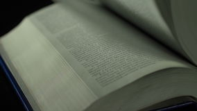 Flipping book pages close up, Slow motion stock footage