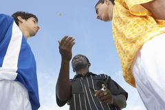 Flipping A Coin Before The Game Royalty Free Stock Photography