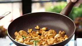 Flipping food in a pan. stock footage