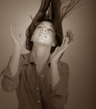 Flipping Hair. Beautiful Image of a fashion Model Flipping her hair Stock Photography