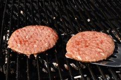 Flipping Hamburgers on the Grill Stock Photos