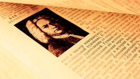 Flipping pages of an old book. Flipping pages of a book closeup with soft focus stock footage