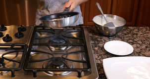 Flipping pancake over in hot frying pan stock footage