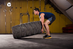 Flipping a tire in a gym Royalty Free Stock Image