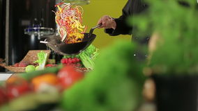 Flipping in a wok stock video