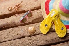 Flips flops and seashells. Royalty Free Stock Photo