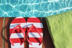 Flips flops by swimming pool Royalty Free Stock Images