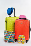 Flips and handbag, two suitcases. Man and woman summer accessories Royalty Free Stock Photo