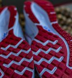 Fresh Start: Shoe sole , spikes , grips of a running shoe stock image