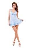 Flirciarska dziewczyna w krótkiej sukni obrazy stock
