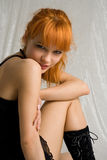 Flirt. Pretty redhead smiling Royalty Free Stock Images