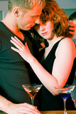 Flirt in a bar Royalty Free Stock Photo