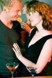 Flirt dans un bar Photographie stock libre de droits