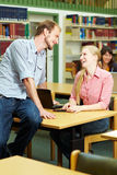 Flirt in library Royalty Free Stock Image