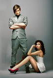 Flirt. Lifestyle. Fashionable Man with Crossed Arms and Gorgeous Woman Stock Photography