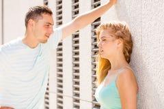 Man flirting with girl on city street Royalty Free Stock Image
