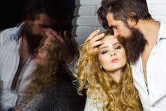 Flirt, relationship, romance. Desire, sensuality, seduction concept. Couple in love reflect in window glass. Intimacy, passion, foreplay. Man with beard hug stock photo