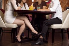 Flirt under cover Royalty Free Stock Image