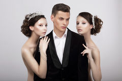 Free Flirtation. Handsome Man In Cuddle Of Two Voluptuous Women Royalty Free Stock Photo - 44430175
