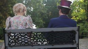 Flirtation in retro style. man glances at the next sitting woman stock video
