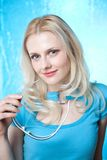 Flirtatious blonde in blue Stock Photos