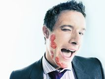 Flirtatious Businessman With Lipstick Kiss Marks. Over his face stock image