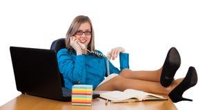 Flirtatious businesswoman. Flirtatious elegant businesswoman chatting on the phone royalty free stock images
