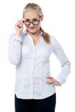 Flirtatious corporate woman staring you Stock Photo