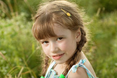 Flirtatious dark-haired girl with pigtails Stock Image