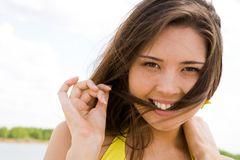 Flirtatious female. Portrait of flirtatious female putting lock of hair in her mouth stock photos