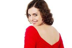 Flirtatious female turning back Stock Images