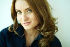 Flirtatious look. Close-up shot of a beautiful girl with flirtatious look smiling at camera royalty free stock image