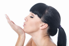 Flirtatious Romantic Beautiful Young Woman Blowing a Kiss Stock Photo
