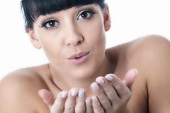 Flirtatious Romantic Beautiful Young Woman Blowing a Kiss. Romantic flirtatious beautiful Young Woman with black hair and hispanic or european features, looking stock photography