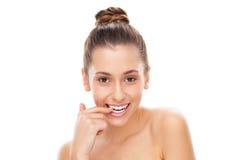 Flirtatious woman biting her nail Stock Image