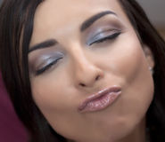 Flirtatious woman. With closed eyes royalty free stock photos