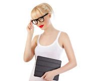 Flirtatious woman holding tablet Royalty Free Stock Photography