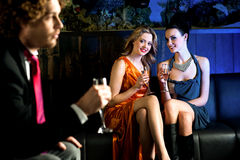 Flirtatious young girls staring at handsome guy royalty free stock images